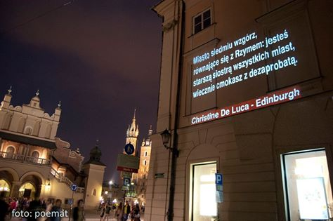 a Polish version of 'Edinburgh Volte-Face' projected onto a wall in the Rynek Główny (main square), Kraków